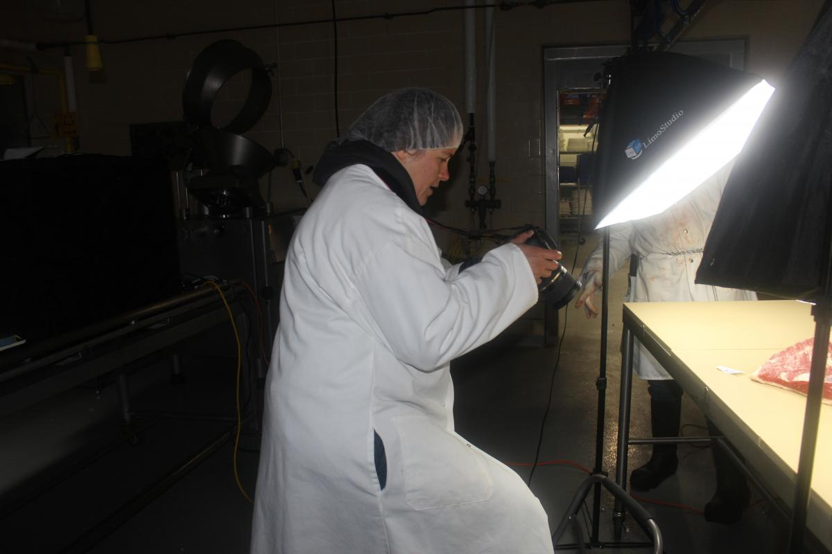 Ohio Wagyu Beef's Allison Willford photographs cuts of meat in the Meat Laboratory