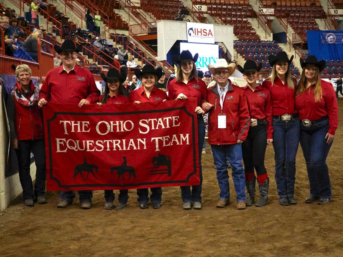 photo courtesy of Lisa Giris, IHSA (L. to R.) Debbie Griffith (Coach), Tyler Kirby, Tori Gonzales, Jillian Channell, Kimberly Hartman, Ollie Griffith (Coach), Morgan Kiehl, Erin Bosse, and Tricia Bellman