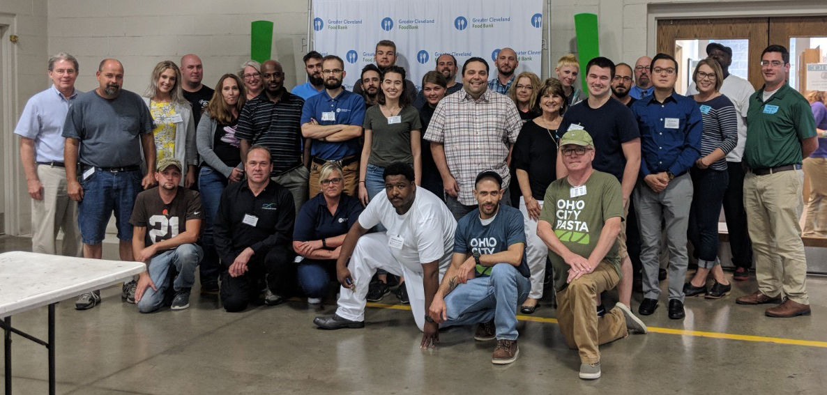 Dr. Lynn Knipe (standing, far left in the blue button-down shirt) and Dr. Daniel Clark (standing, far right in the green polo shirt) at the most recent HACCP training