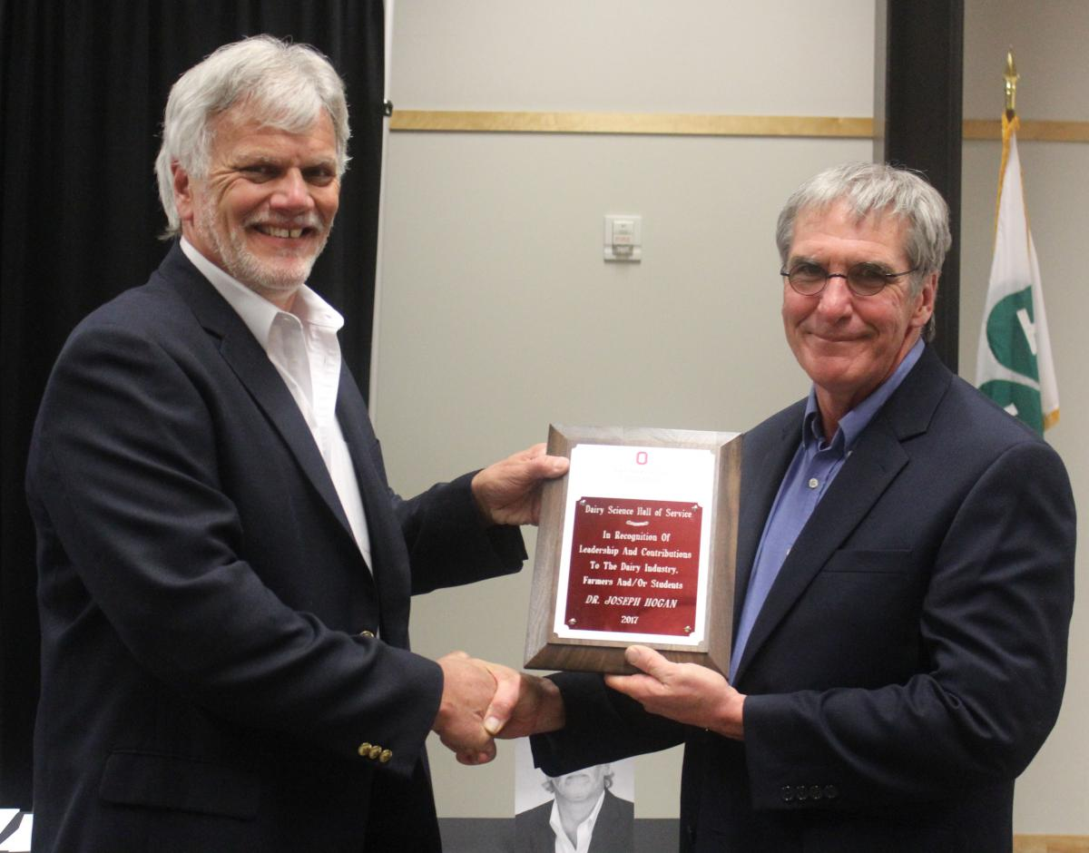 Interim Chair Dr. Bill Weiss inducts Dr. Joseph Hogan into the Dairy Science Hall of Service