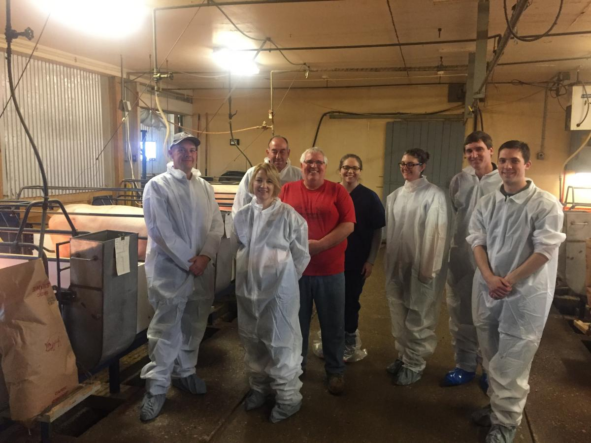 Dr. Jacobi (in black) with Animal Science staff and students provide a tour to swine producers from Australia.