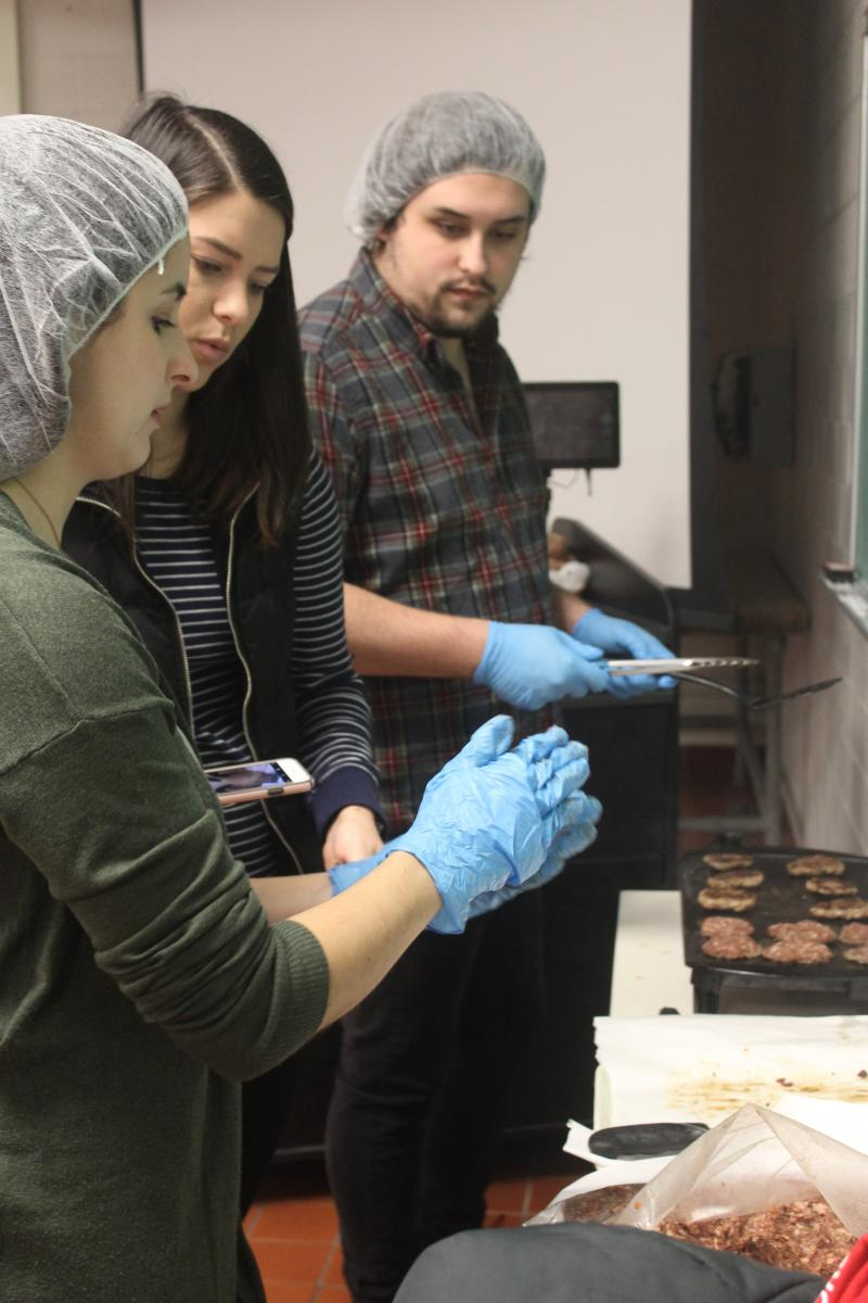 Students prepare maple bacon breakfast sausage